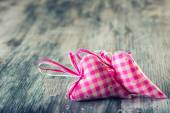 Pink hearts on wooden background. — Stockfoto