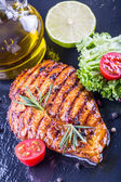 Steak chicken breast olive oil cherry tomatoes pepper and rosemary herbs. — Stock Photo