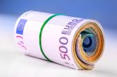 Rolled euro banknotes several thousand.Free space for your economic information — Stock Photo