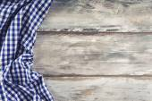 Top view of checkered napkin on wooden table. — Stock Photo