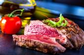 Grilled Beef steak with vegetable decoration. Grilled porterhouse steak. — Stock Photo