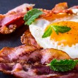 Ham and Egg. Bacon and Egg. Salted egg and sprinkled with black pepper and green herb decoration. — Stock Photo #71774355
