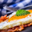 Ham and Egg. Bacon and Egg. Salted egg and sprinkled with black pepper and green herb decoration. — Stock Photo #71774367