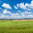 Scenic Tuscany landscape with rolling hills in Val d'Orcia, Italy — Stock Photo #58674999