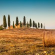 Scenic Tuscany landscape with farm house at sunset, Val d'Orcia, Italy — Stock Photo #58675569
