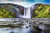 Long exposure of famous Skogafoss waterfall in Iceland at dusk — Stock Photo