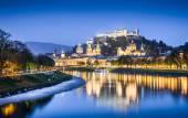 Historic city of Salzburg with Festung Hohensalzburg and river Salzach at dusk, Austria — Stock Photo