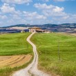 Scenic Tuscany landscape with traditional farm house, Val d'Orcia, Italy — Stock Photo #68473485