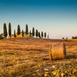 Tuscany landscape with farm house at sunset, Val d'Orcia, Italy — Stock Photo #68474135