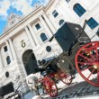 Famous Hofburg Palace with traditional Fiaker carriages in Vienna, Austria — Stock Photo #68478389