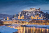 Historic city of Salzburg in winter at dusk, Salzburger Land, Austria — Stockfoto