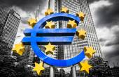 Euro sign with dark dramatic clouds symbolizing financial crisis — Stock Photo