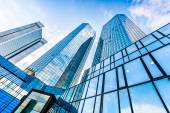 Modern skyscrapers in business district with blue sky — Stock Photo