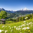 Idyllic mountain landscape in the Alps with traditional mountain lodge in springtime — Stock Photo #68481213