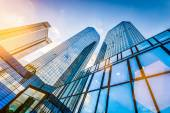Modern skyscrapers in business district at sunset — Stock Photo