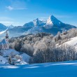 Panoramic view of beautiful winter landscape in the Bavarian Alps with pilgrimage church of Maria Gern and famous Watzmann massif in the background, Nationalpark Berchtesgadener Land, Bavaria, Germany — Stock Photo #79028362
