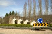 Road signs in stone wall — Stock Photo