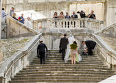 Just married on the stairs — Stock Photo