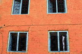 Blue windows-red brick facade-Thrangu Tashi Yangtse monastery. Namo Buddha-Nepal. 1018 — Stock Photo