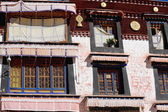 Windows-golden roundels in Drepung monastery. Lhasa-Tibet-China. 1214 — Stock Photo