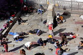 Tibetan devotees at pray and prostrate. Jokhang-Lhasa-Tibet. 1432 — Stock Photo