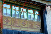 Wooden window with buddhist symbols. Gyantse-Tibet. 1606 — Stock Photo