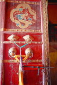 Red lacquered wooden door in Tsuklakhang temple. Gyantse-Tibet. 1631 — Stock Photo