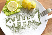 Silhouette fish in dill on plate abstract food concept — Stock Photo