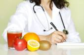 Doctor nutritionist in office with healthy fruits diet concept — Foto de Stock
