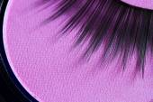 Eyelashes and eye shadow cosmetics abstract background — Stock Photo