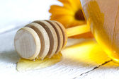 Jar of honey closeup on white planks — Stock Photo