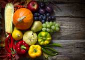 Autumn fruits and vegetables on vintage boards — Stock Photo