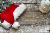 Santa Claus hat on vintage wooden boards christmas background — Zdjęcie stockowe