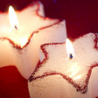 Christmas candle star in red closeup — Stock Photo #57722711
