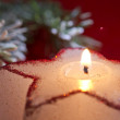 Christmas candle star in red closeup — Stock Photo #57723337