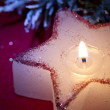 Christmas candle star in red closeup — Stock Photo #57723405