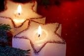 Christmas candle star in red closeup — Stock fotografie