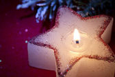 Christmas candle star in red closeup — Stock Photo