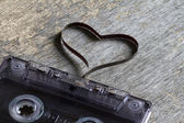 Audio cassette with heart magnetic tape abstract love concept — Foto de Stock