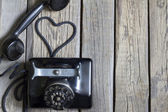 Old retro telephone with heart shape abstract concept — Stock Photo