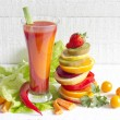 Fresh spring juice and pile of slice fruits and vegetables — Stock Photo #66388901