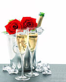 Two glasses, bottle of champagne and red roses — Stock Photo