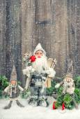 Santa Claus and happy kids in snow. Christmas decoration — Stock Photo