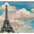 Vintage postcard from paris with eiffel tower over blue sky — Stock Photo #52411075