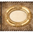 Vintage photo album. leather cover and golden frame — Stock Photo