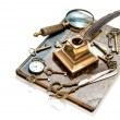 Antique keys, pocket watch, ink pen, loupe, book — Stock Photo #52414237