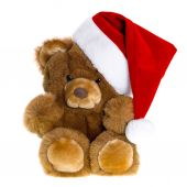 Cute vintage teddy bear with red santa hat — Stock Photo