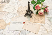 Roses, antique french postcards and Eiffel Tower Paris — Stock Photo