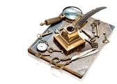 Antique keys, pocket watch, ink pen, loupe, book — Stockfoto
