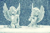 Little guardian angels in snow. christmas decoration — Stock Photo